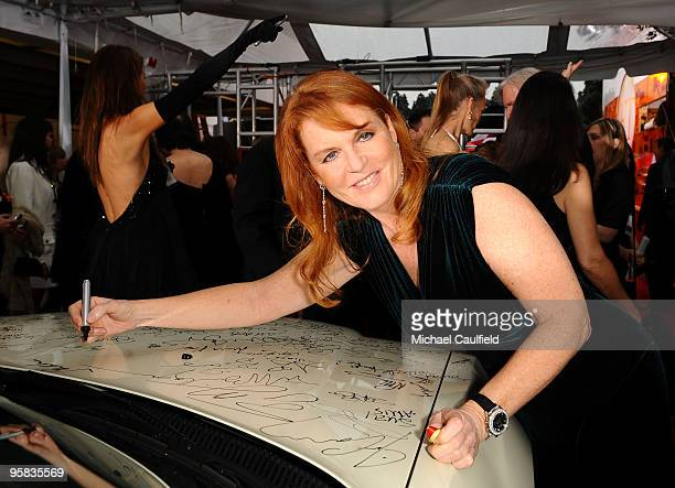 Duchess of York Sarah Ferguson signs the Chrysler 300 Eco Style car for Stars for a Cause during the 67th annual Golden Globe Awards held at The...