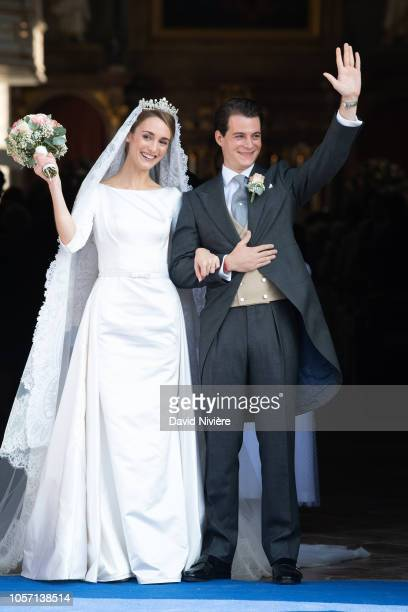Duchess Sophie of Wurtemberg and Count Maximilien of Andigne get out of the SaintQuirin church after their wedding at the Castle of Tegernsee on...