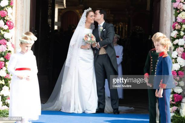 Duchess Sophie of Wurtemberg and Count Maximilien of Andigne get out of the Saint-Quirin church after their weddingat the Castle of Tegernsee on...