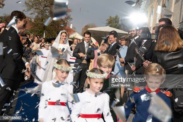 Duchess Sophie of Wurtemberg and Count Maximilien of Andigne leave SaintQuirin church after their wedding at the Castle of Tegernsee on October 20...