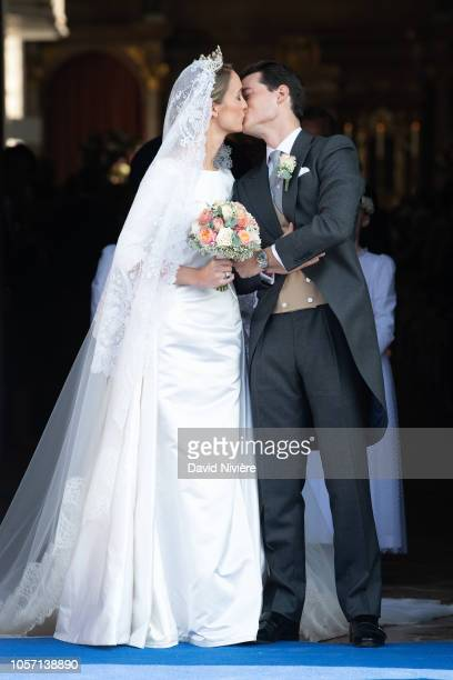 Duchess Sophie of Wurtemberg and Count Maximilien of Andigne share a kiss as they leave the SaintQuirin church after their wedding at the Castle of...