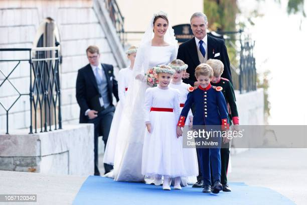 Duchess Sophie of Wurtemberg arrives at the SaintQuirin Church prior her wedding with her father Prince Philip of Wurtemberg at the Castle of...