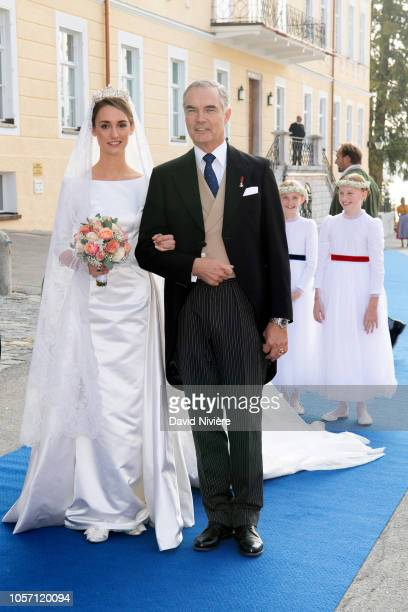 Duchess Sophie of Wurtemberg arrives at the SaintQuirin Church with her father Prince Philip of Wurtemberg prior to her wedding at the Castle of...