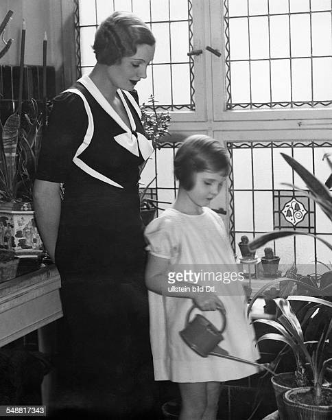 Duchess with her daughter watering flowers Published in 'Dame' 10/1934 Photographer J Amster
