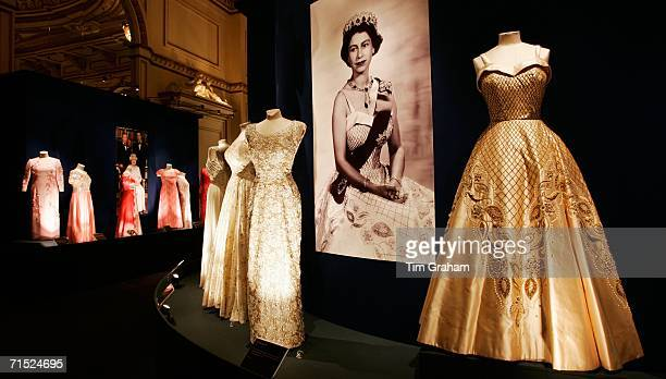 Duchesse satin and gold lame embroidered dress designed by Sir Norman Hartnell stands on display at an exhibition for the summer opening of the State...