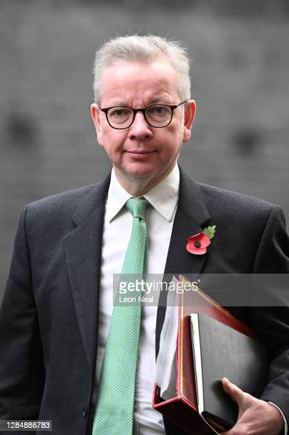 Duchy of Lancaster Michael Gove walks through Downing Street as he heads to the weekly Cabinet meeting at the Foreign Office on November 10, 2020 in...