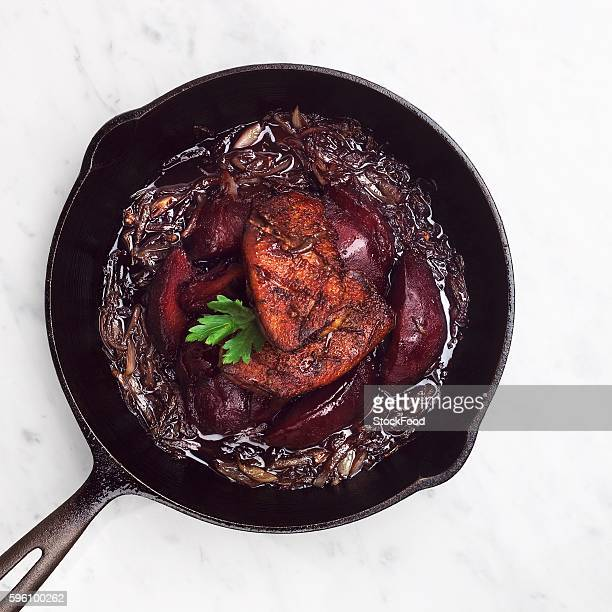 Duck and Poached Quince in a Cast Iron Skillet with Caramelized Onions