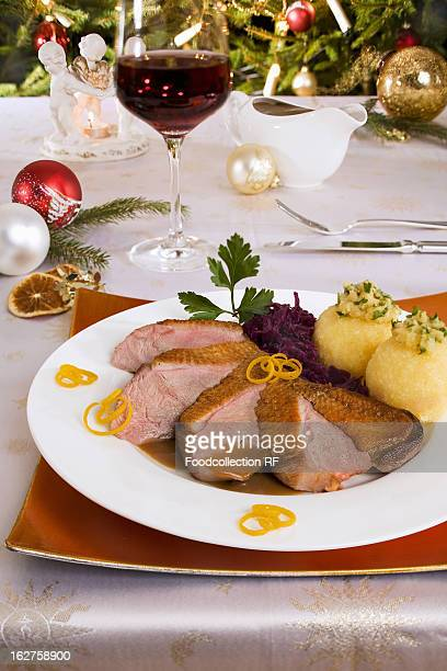 Duck breast with red cabbage and potato dumplings for Christmas dinner