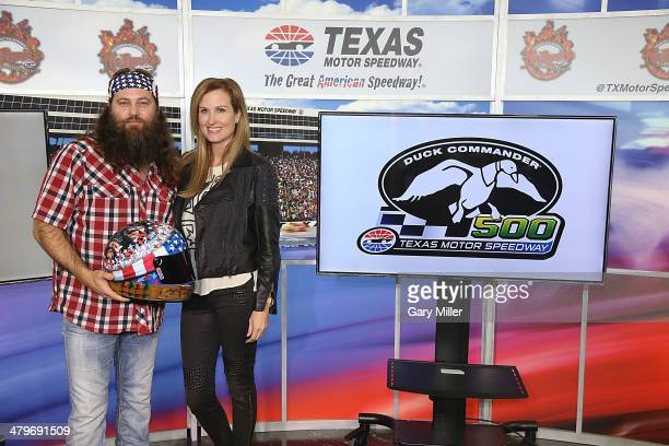 Duck Commander CEO Willie Robertson and wife Korie Robertson pose after the press conference for the unveiling of Big Hoss the largest HD video board...