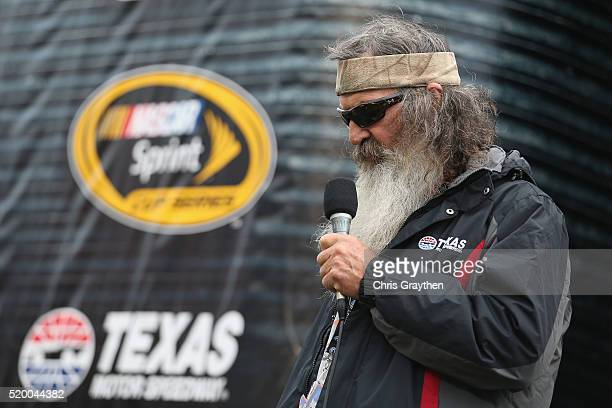 Duck Dynasty's Phil Robertson gives the invocation prior to the NASCAR Sprint Cup Series Duck Commander 500 at Texas Motor Speedway on April 9 2016...