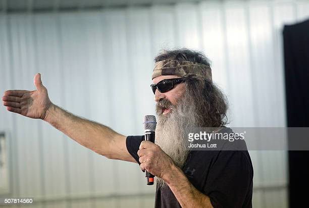Duck Dynasty's Phil Robertson speaks about Republican presidential candidate Ted Cruz during a campaign event at the Johnson County Fairgrounds...