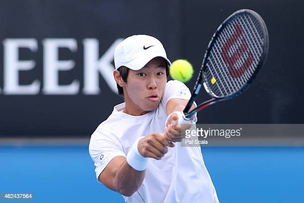 Duck Hee Lee of Korea plays a backhand in his match against Akira Santillan of Australia during the Australian Open 2015 Junior Championships at...
