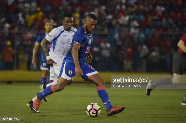 Duckens Nazon of Haiti runs with the ball during the math against Nicaragua at the Sylvio Cator Stadium in PortauPrince on March 24 the first of two...