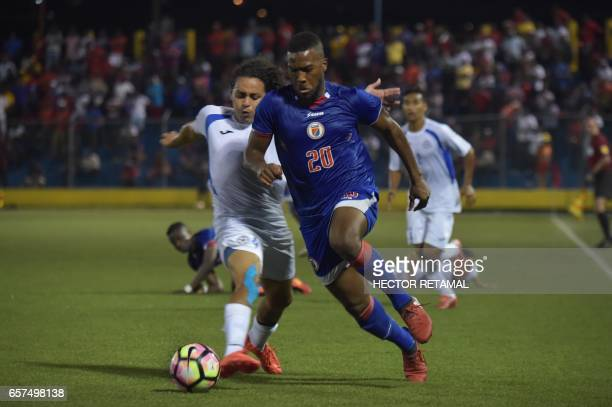 Duckens Nazon of Haiti vies for the ball with Jason Casco of Nicaragua during the first of two match to define the last qualified to the 2017 Gold...