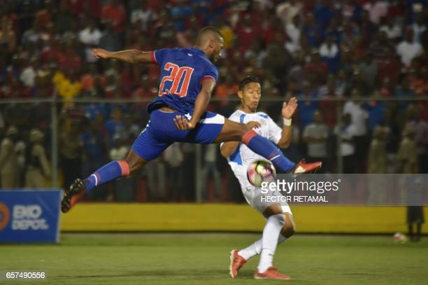 Duckens Nazon of Haiti vies for the ball with Josue Quijano of Nicaragua during the first of two match to define the last qualified to the 2017 Gold...