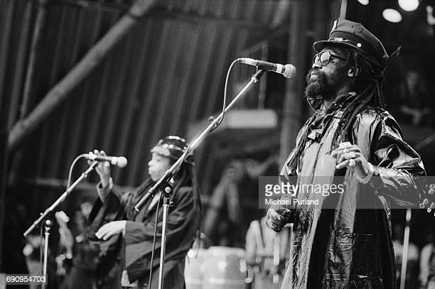 Duckie Simpson and Sandra 'Puma' Jones performing with Black Uhuru and The Wailers at the Glastonbury Festival near Pilton Somerset 21st June 1986