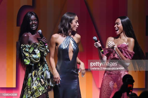 Duckie Thot Alanna Arrington and Winnie Harlow perform at the amfAR Gala dinner at La Permanente on September 22 2018 in Milan Italy