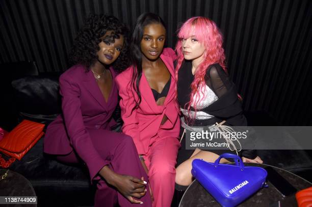 Duckie Thot Leomie Anderson and Anna Trevelyan attend the launch of the ESCADA Heartbag by Rita Ora on March 27 2019 in New York City