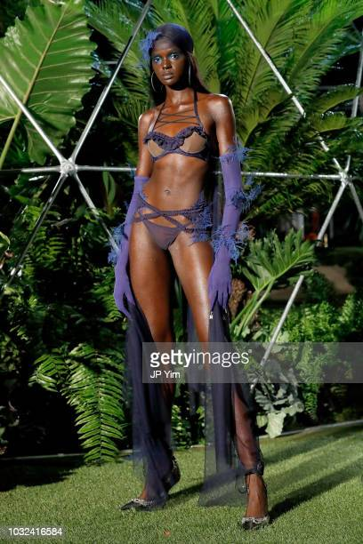 Duckie Thot walks the runway for the Savage X Fenty Fall/Winter 2018 fashion show during NYFW at the Brooklyn Navy Yard on September 12 2018 in...