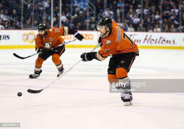 Ducks Andrew Cogliano passes the puck during the NHL game between the Winnipeg Jets and the Anaheim Ducks on March 30 2017 at the MTS Centre in...