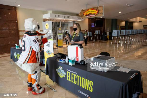 "Ducks mascot Wild Wing demonstrates how to vote during a media preview Wednesday, September 16, 2020 to showcase how the ""Super Vote Center Site""..."