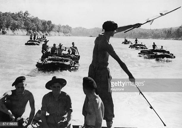 Ducks or amphibious vehicles bring supplies along the Chindwin River in Burma to the British troops closing on Mandalay during World War II circa...