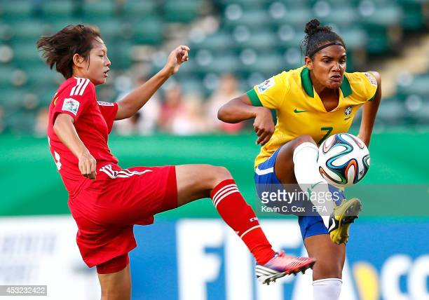 Duda of Brazil controls the ball against Lyu Siqi of China PR at Commonwealth Stadium on August 5 2014 in Edmonton Canada