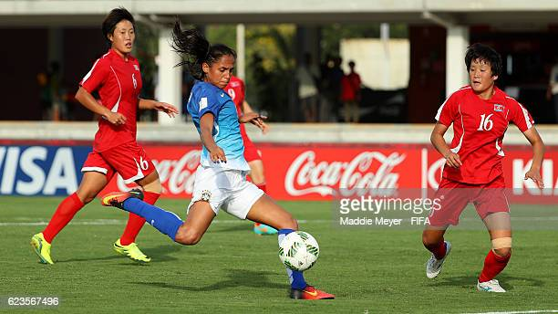 Duda of Brazil takes a shot against Korea DPR with pressure from Ri Un Yong during the first half of their Group A match of the FIFA U20 Women's...