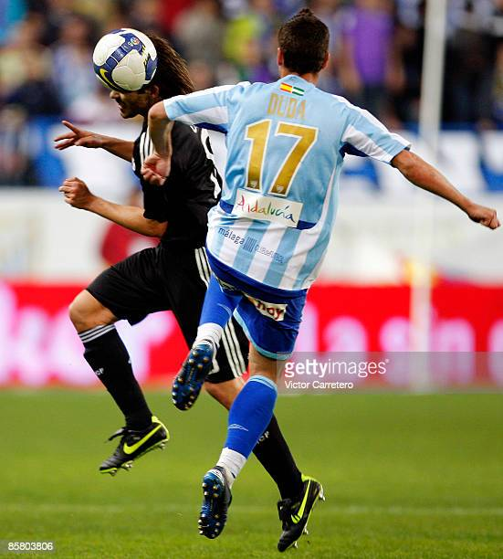 Duda of Malaga fights for the ball with Fernando Gago of Real Madrid during the Primera League match between Malaga and Real Madrid at La Rosaleda on...