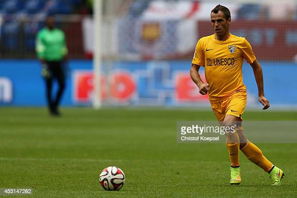 Duda of Malaga runs with the ball during the match between FC Malaga and West Ham United as part of the Schalke 04 Cup Day at VeltinsArena on August...