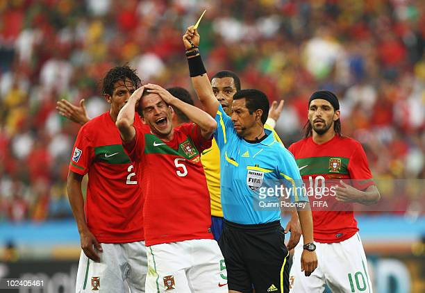 Duda of Portugal is booked yellow card by referee Benito Archundia during the 2010 FIFA World Cup South Africa Group G match between Portugal and...