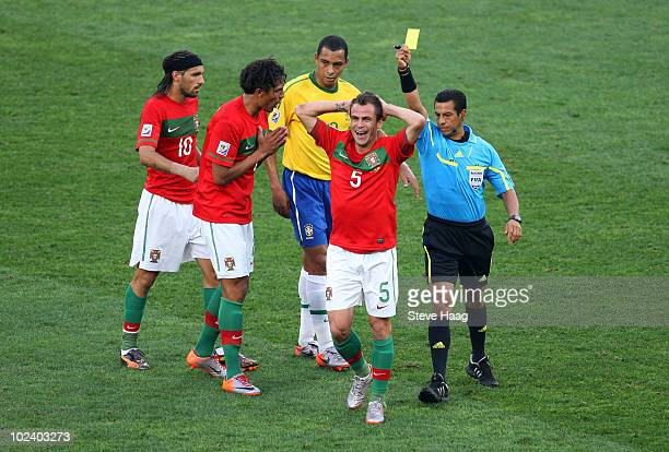 Duda of Portugal reacts as he is given a yellow card by Referee Benito Archundia during the 2010 FIFA World Cup South Africa Group G match between...