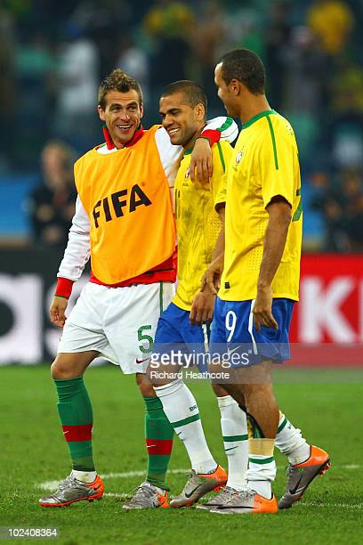 Duda of Portugal talks with Dani Alves and Luis Fabiano of Brazil after the 2010 FIFA World Cup South Africa Group G match between Portugal and...