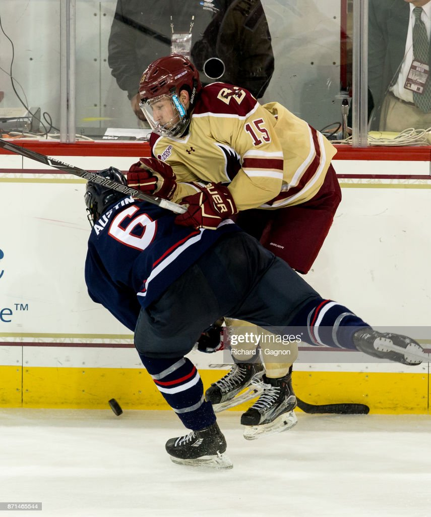 JD Dudek #15 of the Boston College Eagles checks Johnny Austin #6 of the Connecticut Huskies during NCAA hockey at Kelley Rink on November 7, 2017 in Chestnut Hill, Massachusetts. The Eagles won 2-1.