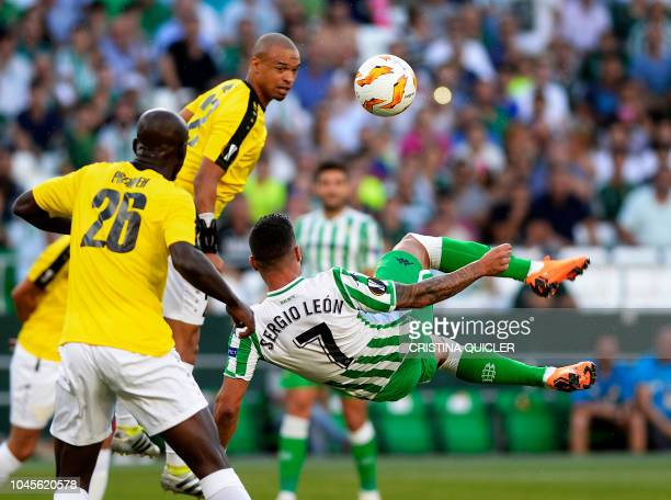 F91 Dudelange's French defender Bryan Melisse jumps for the ball next to Real Betis' Spanish forward Sergio Leon Limones during the UEFA Europa...