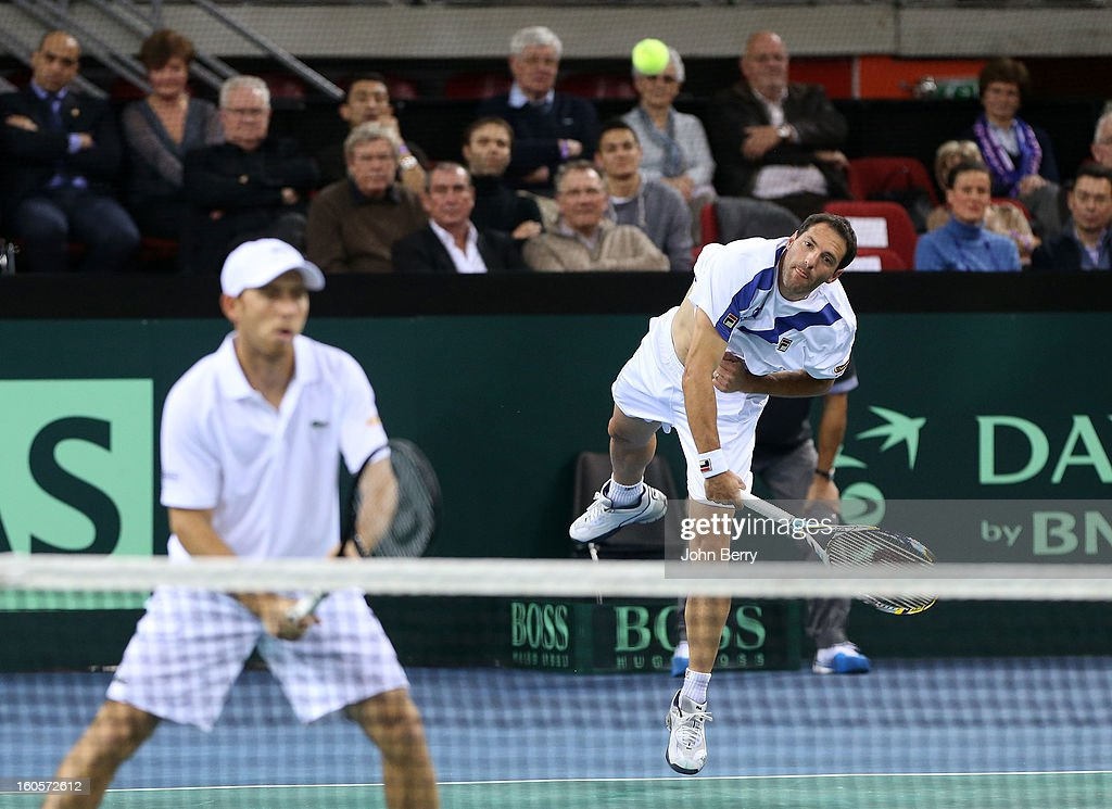Dudi Sela (L) and Jonathan Erlich of Israel in action during their doubles match against Julien Bennetteau and Michael Llodra of France on day two of the Davis Cup first round match between France and Israel at the Kindarena stadium on February 2, 2013 in Rouen, France.