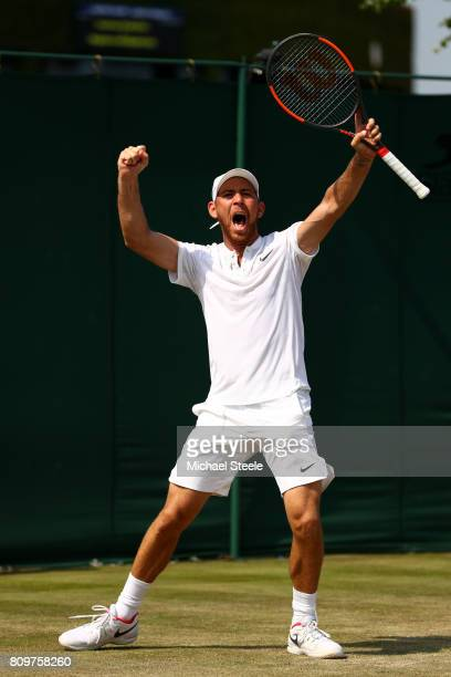 Dudi Sela of Israel celebrates match point and victory during the Gentlemen's Singles second round match aganst John Isner of The United States on...