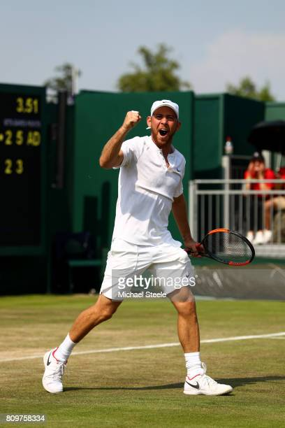 Dudi Sela of Israel celebrates victory during the Gentlemen's Singles second round match aganst John Isner of The United States on day four of the...