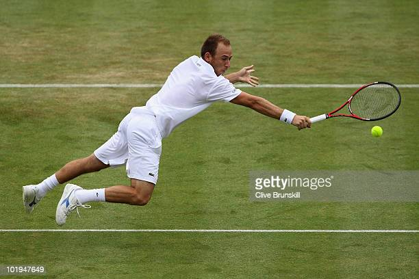 Dudi Sela of Israel dives to win match point during his third round match against Andy Roddick of USA on Day 4 of the the AEGON Championships at...