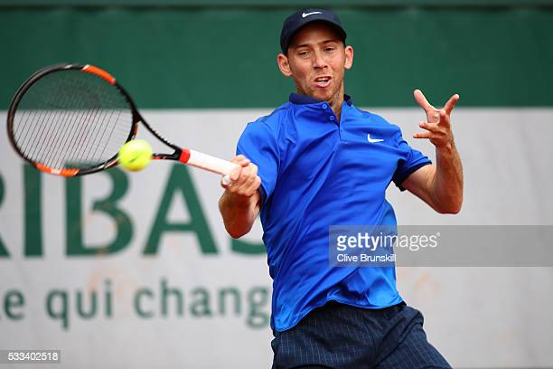 Dudi Sela of Israel hits a forehand during the Mens Singles first round match against Dustin Brown of Germany on day one of the 2016 French Open at...