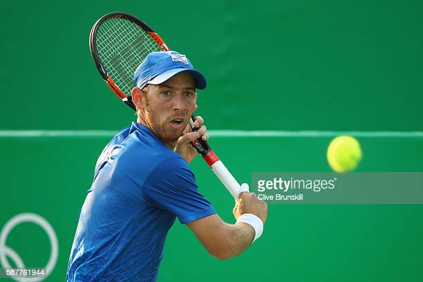 Dudi Sela of Israel hits during the men's second round singles match against David Goffin of Belgium on Day 4 of the Rio 2016 Olympic Games at the...