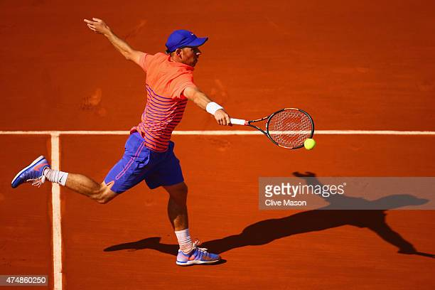 Dudi Sela of Israel lays a backhand in his Men's Singles match against JoWilfried Tsonga of France during day four of the 2015 French Open at Roland...