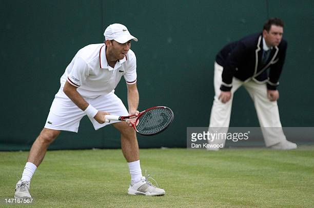 Dudi Sela of Israel looks on during his mens singles first round match against Ivo Karlovic of Croatia on day two of the Wimbledon Lawn Tennis...