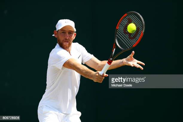 Dudi Sela of Israel plays a backhand during the Gentlemen's Singles second round match against John Isner of The United States on day four of the...