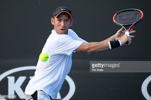 Dudi Sela of Israel plays a backhand in his first round match against Marcel Granollers of Spain on day one of the 2017 Australian Open at Melbourne...