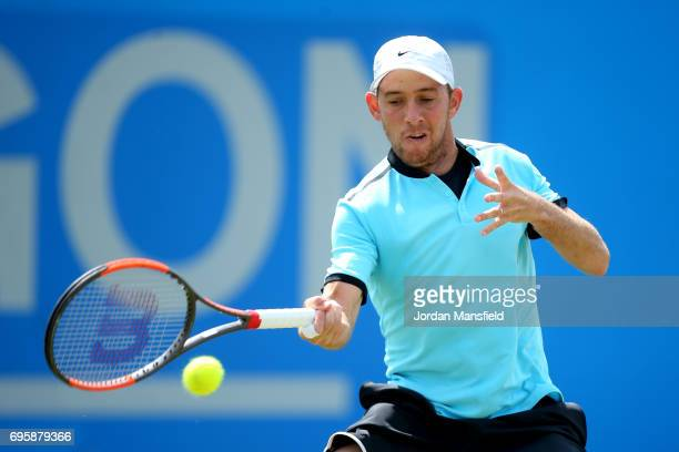 Dudi Sela of Israel plays a forehand during his Men's second round match against Ricardas Berankis of Lithuania during day three of the Aegon Open...