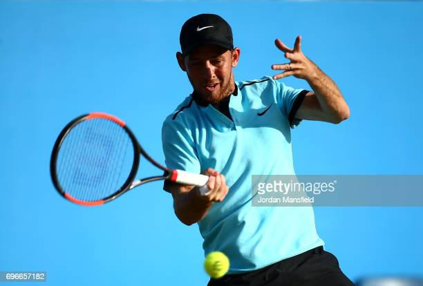 Dudi Sela of Israel plays a forehand during his Men's Singles quarterfinal match against Lloyd Glasspool of Great Britain during day five of the...