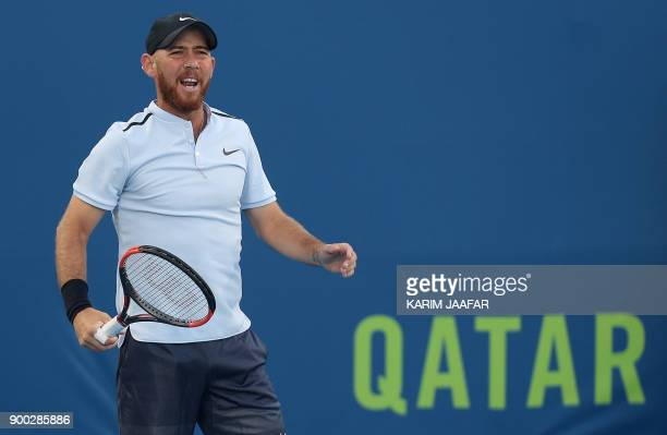 Dudi Sela of Israel reacts after playing a point against Spanish tennis player Fernando Verdasco during the first round of the ATP Qatar Open tennis...