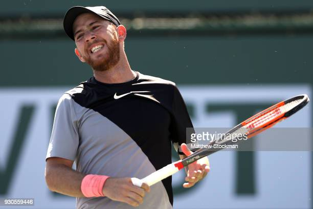 Dudi Sela of Israel reacts to a lost point while playing Kyle Edmund of Great Britai during the BNP Paribas Open at the Indian Wells Tennis Garden on...