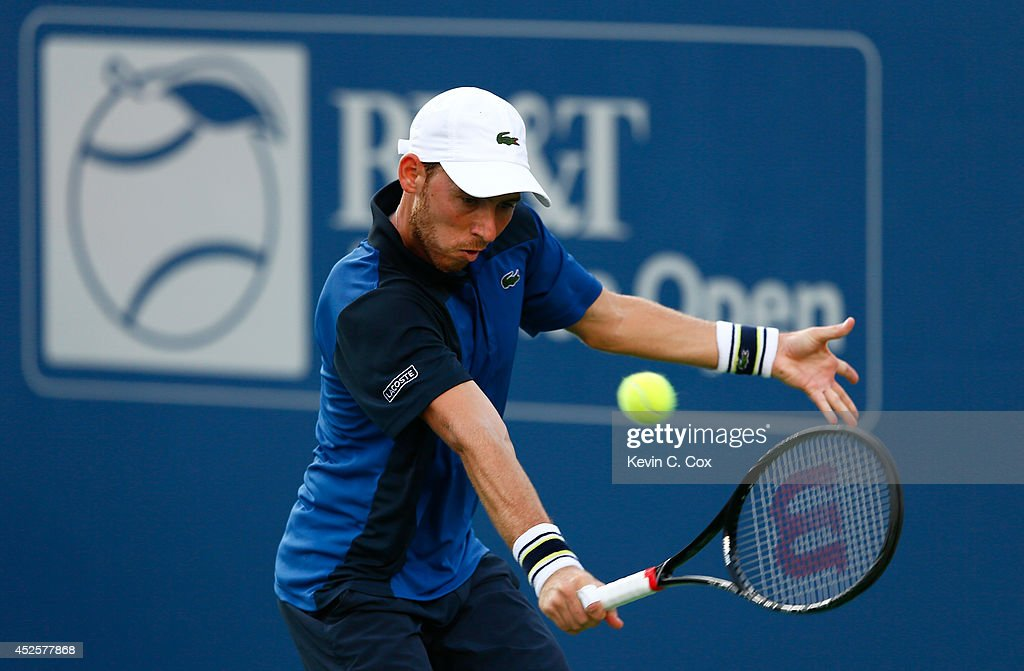 Dudi Sela of Israel returns a backhand to Sam Querrey during the BB&T Atlanta Open at Atlantic Station on July 23, 2014 in Atlanta, Georgia.